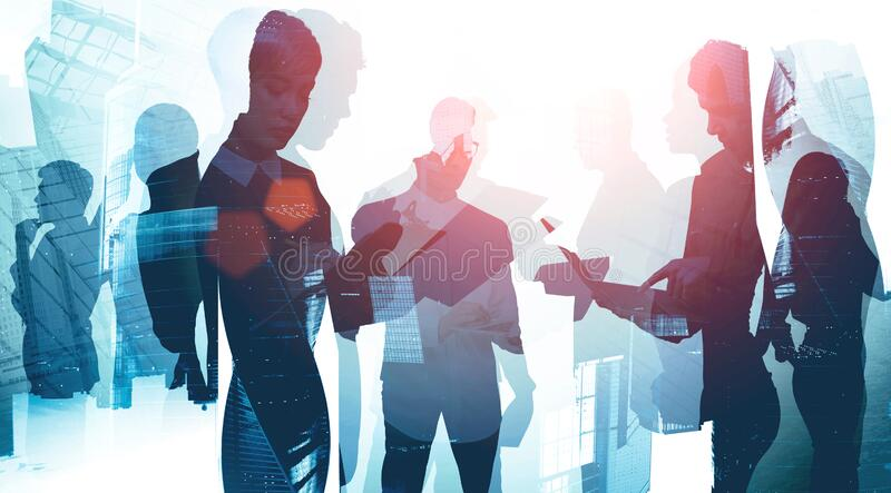 International business team in modern city. International diverse business team working together in Moscow city with gadgets and documents. Teamwork and royalty free stock photo