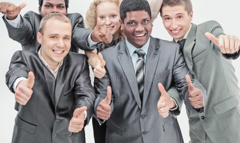International business team showing thumbs up. the concept of t stock photography