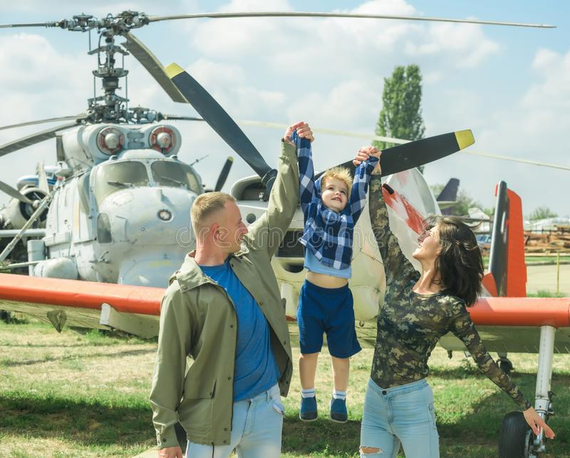 International childrens day. Child with parents at air show on international childrens day. Son with mother and father stock photography