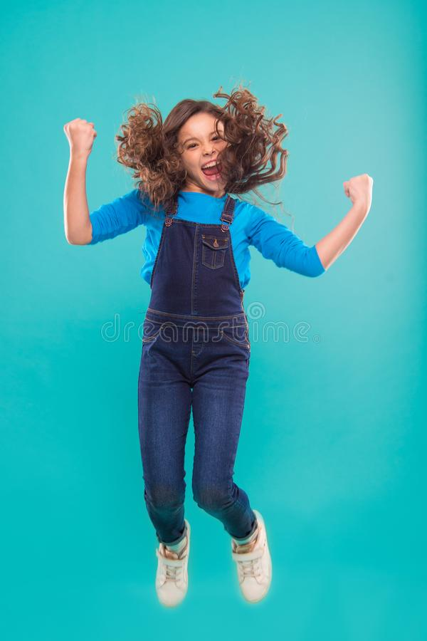 International childrens day. small kid fashion. small girl child with perfect hair. Happy little girl. Beauty and royalty free stock photos