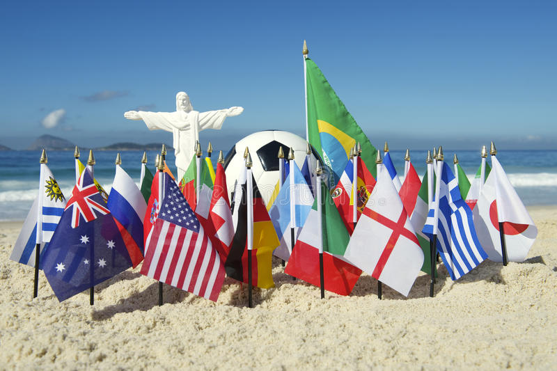 International Country Flags Cristo Soccer Football Rio Brazil. Statue of Christ standing over International football country flags with soccer ball on Ipanema royalty free stock photography