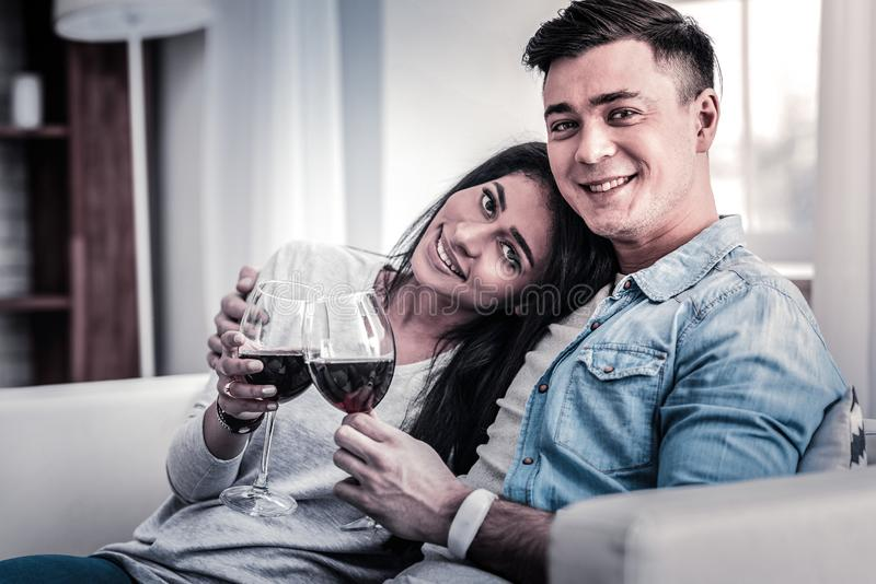 International couple drinking red wine while hugging royalty free stock images