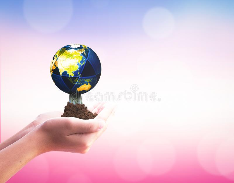 International Day of Cooperatives concept: hands holding Earth  on blurred  nature background stock photos