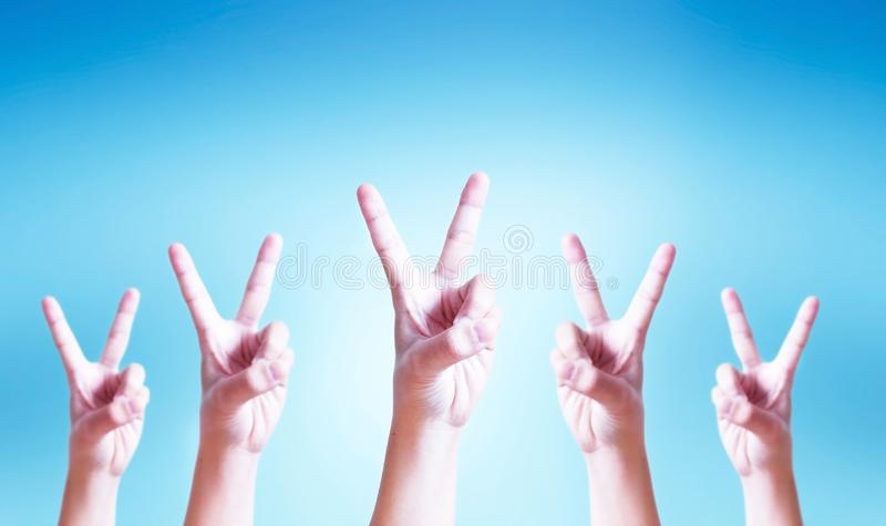 International Day of Cooperatives concept: human hands showing v-sign stock photography