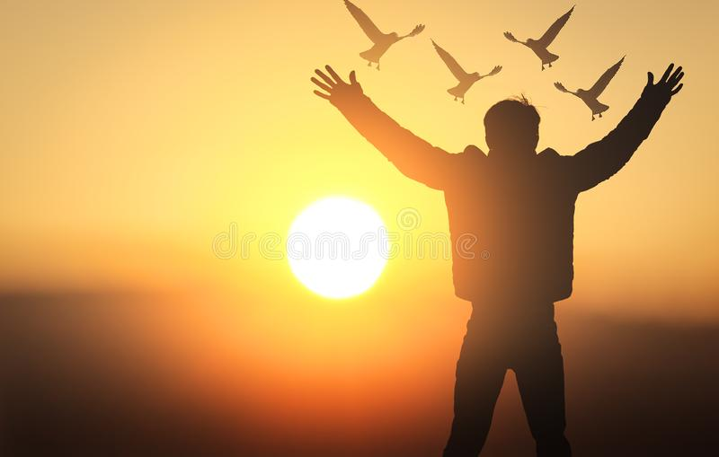International Day of Peace concept: silhouette young men were praying royalty free stock photos