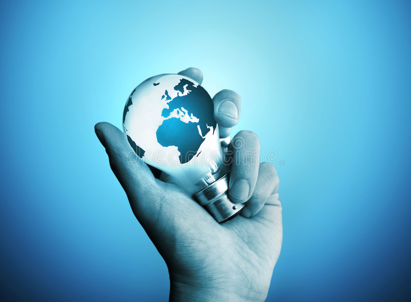 International Energy. A man holding a bulb with the world on it royalty free stock photography