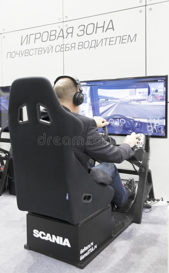 International Exhibition. MOSCOW, SEPTEMBER 12: The simulator of the Swedish companies SCANIA for driver training at the International Exhibition COMTRANS on royalty free stock photo
