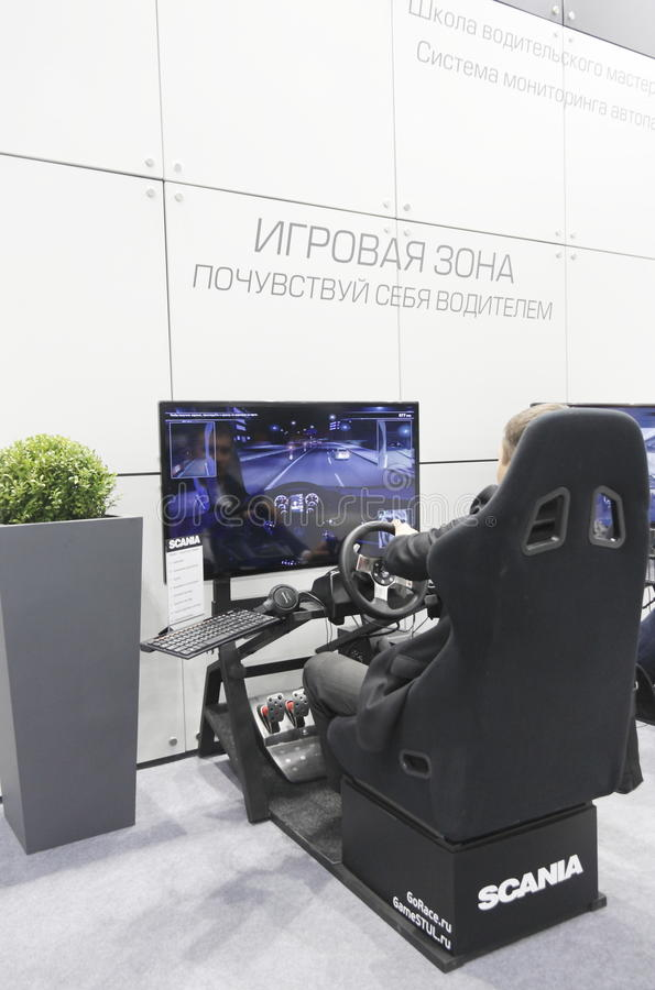 International Exhibition. MOSCOW, SEPTEMBER 12: The simulator of the Swedish companies SCANIA for driver training at the International Exhibition COMTRANS on royalty free stock photos