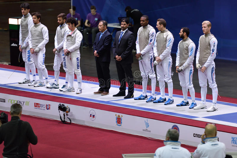 International fencing tournament St. Petersburg Foil 2015. St. Petersburg, Russia - May 3, 2015: Teams Italy and France before the match for 3rd place of stock photo