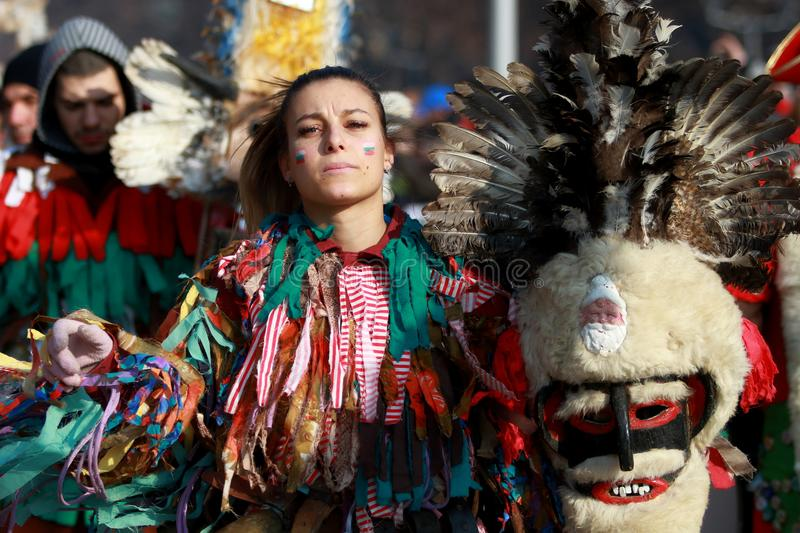 International Festival of Masquerade Games Surva in Pernik. Pernik, Bulgaria - January 28, 2018: People with mask called Kukeri dance and perform to scare the stock images