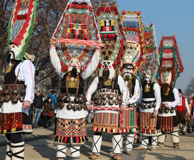 International Festival of Masquerade Games Surva in Pernik. Pernik, Bulgaria - January 28, 2018: People with mask called Kukeri dance and perform to scare the royalty free stock photo