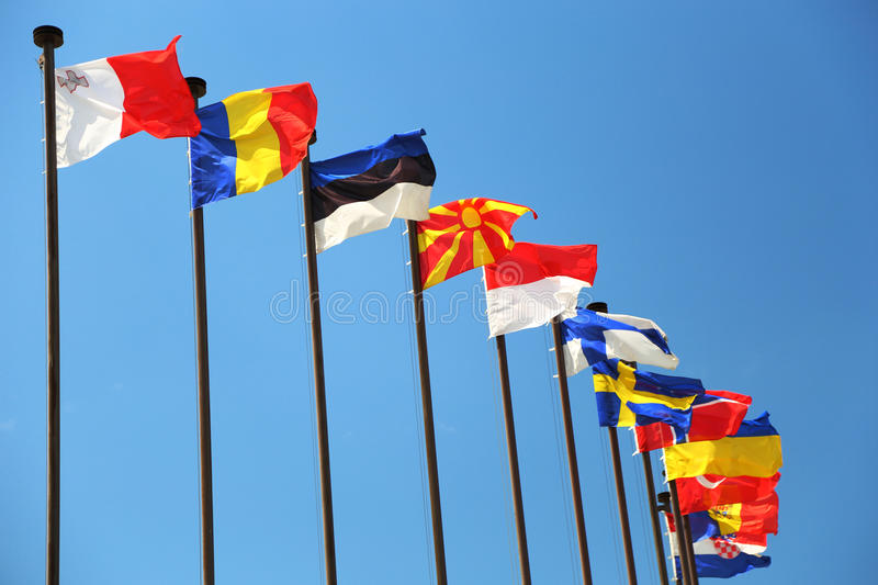 International flags against the sky. Background - international flags against the sky stock image