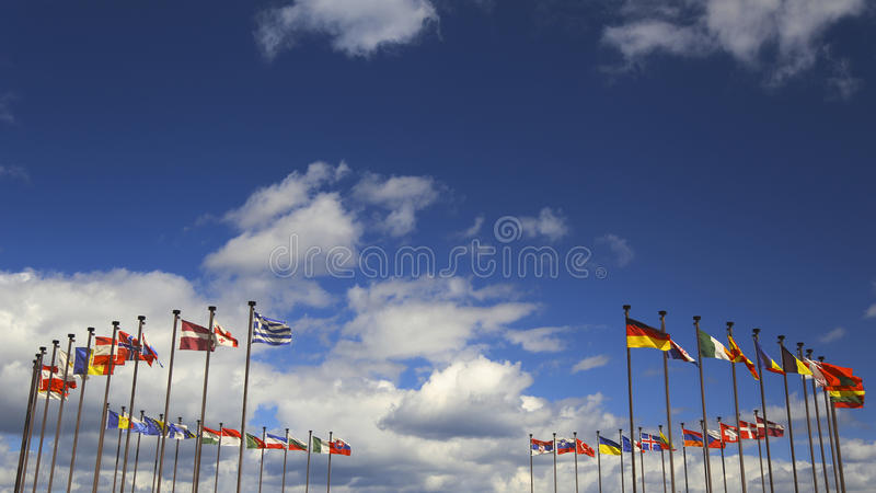 International flags against the sky. Background - international flags in the wind against the sky stock photography