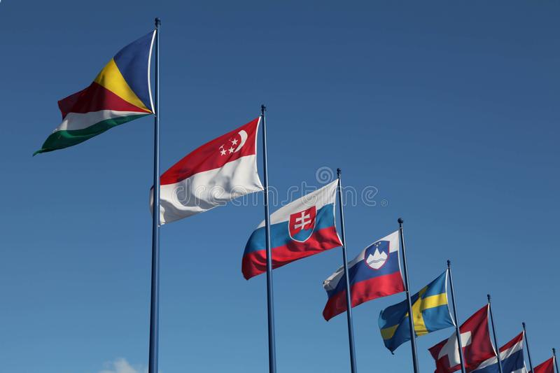 International Flags On Sky Background Stock Images