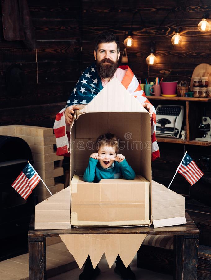 International friendship, freedom and people concept - happy family with american flag at paper rocket. royalty free stock photo