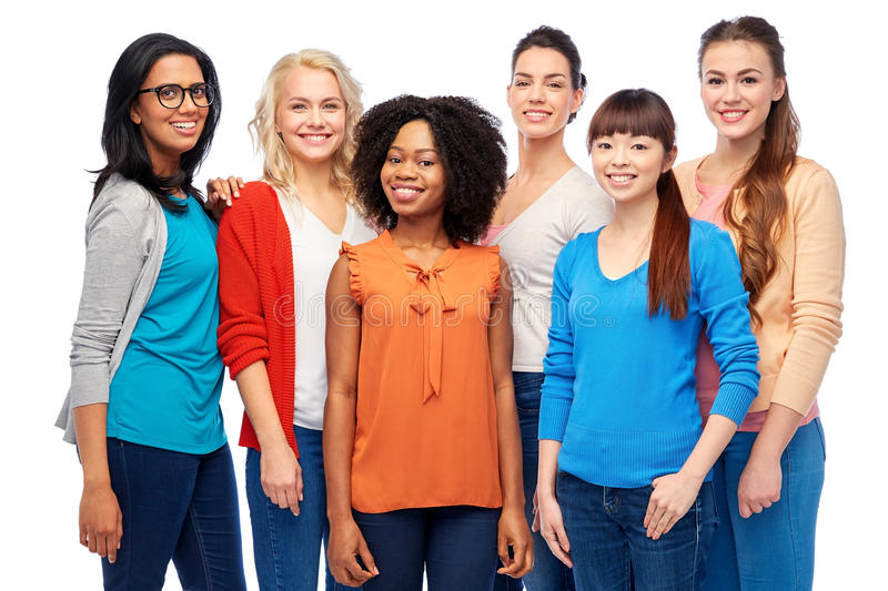 International group of happy smiling women. Diversity, race, ethnicity and people concept - international group of happy smiling different women over white royalty free stock images