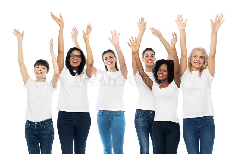 International group of happy smiling women. Diversity, race, ethnicity and people concept - international group of happy smiling different women in white blank t royalty free stock photography
