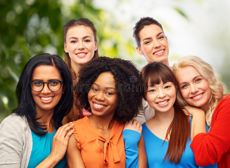 International group of happy women hugging stock images