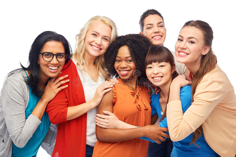 International group of happy women hugging. Diversity, race, ethnicity and people concept - international group of happy smiling different women over white stock photography
