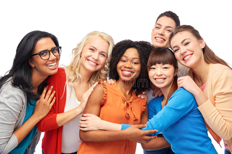 International group of happy women hugging. Diversity, race, ethnicity and people concept - international group of happy smiling different women over white royalty free stock photos