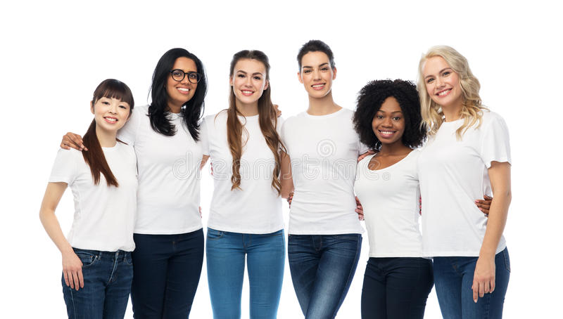 International group of happy women hugging. Diversity, race, ethnicity and people concept - international group of happy smiling different women in white blank t royalty free stock images