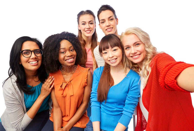 International group of happy women taking selfie. Diversity, race, ethnicity and people concept - international group of happy smiling different women over white stock photos