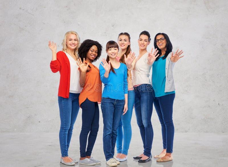 International group of happy women waving hands. Diversity, race, ethnicity, gesture and people concept - international group of happy smiling different women stock photography