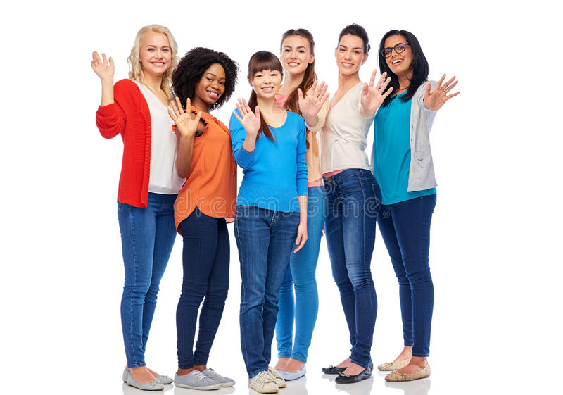 International group of happy women waving hands. Diversity, race, ethnicity, gesture and people concept - international group of happy smiling different women stock photo