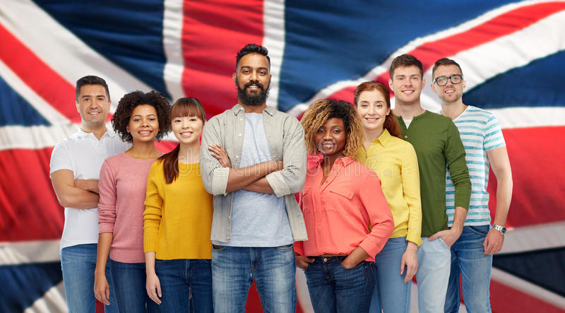 International group of people over british flag royalty free stock image