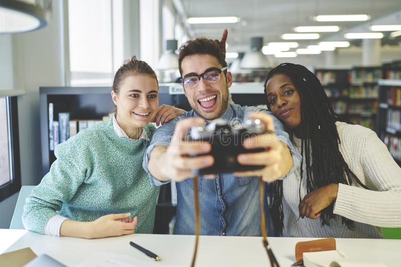 International group of students spending free time together making memory pictures royalty free stock images