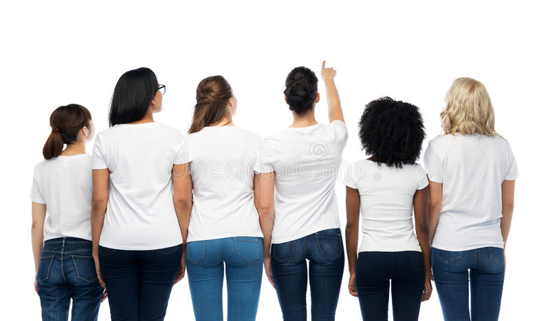 International group of women from back. Diversity, race, ethnicity and people concept - international group of different women in white blank t-shirts from back royalty free stock images