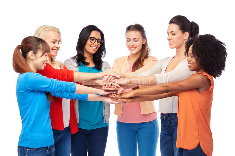 International group of women with hands together. Diversity, race, ethnicity, community and people concept - international group of happy smiling different women royalty free stock photo