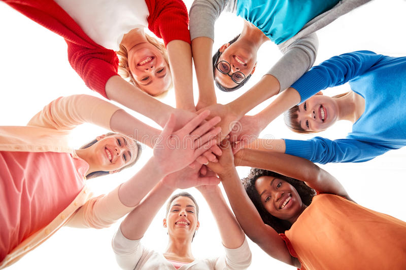 International group of women with hands together. Diversity, race, ethnicity and people concept - international group of happy smiling different women over white stock photos