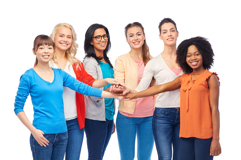 International group of women with hands together. Diversity, race, ethnicity and people concept - international group of happy smiling different women over white royalty free stock photos