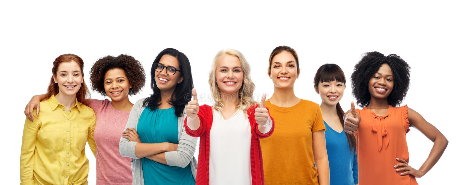 International group of women showing thumbs up. Diversity, feminism and international people concept - group of happy smiling different women over white showing royalty free stock images
