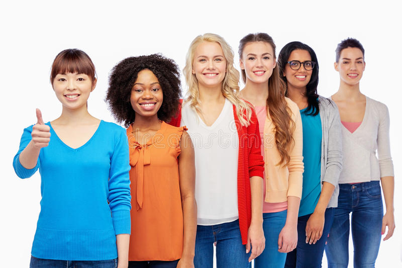 International group of women showing thumbs up. Diversity, race, ethnicity, gesture and people concept - international group of happy smiling different women stock photography