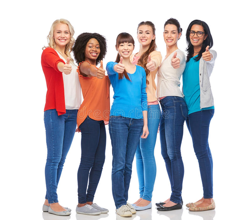 International group of women showing thumbs up. Diversity, race, ethnicity and people concept - international group of happy smiling different women over white stock photo