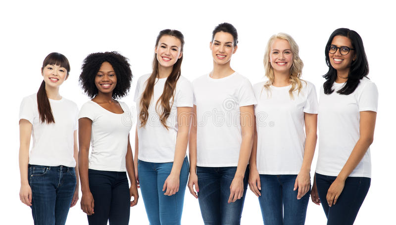 International group of women in white t-shirts royalty free stock image