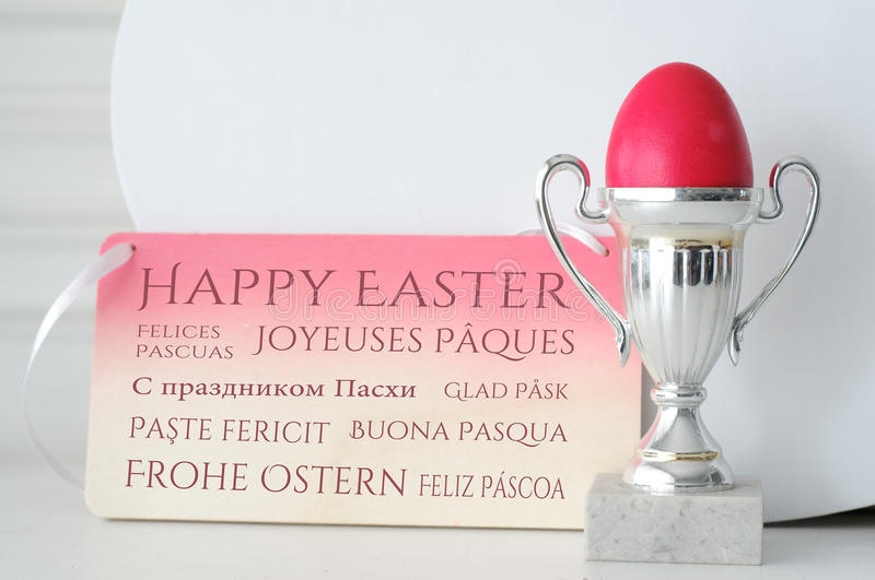 International Happy Easter Greetings. With Egg Cup royalty free stock photography