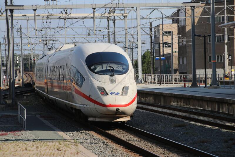international ICE train from Berlin to Amsterdam on Utrecht central station along platform royalty free stock images