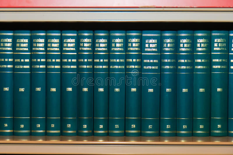 International Law Books in Bookshelf royalty free stock photo