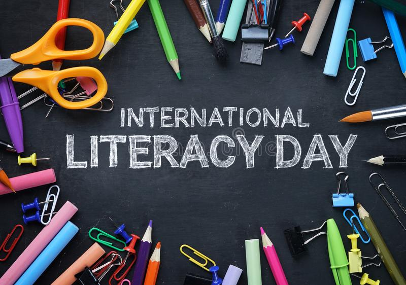 International Literacy Day. School Stationary Top View on Blackboard royalty free stock images