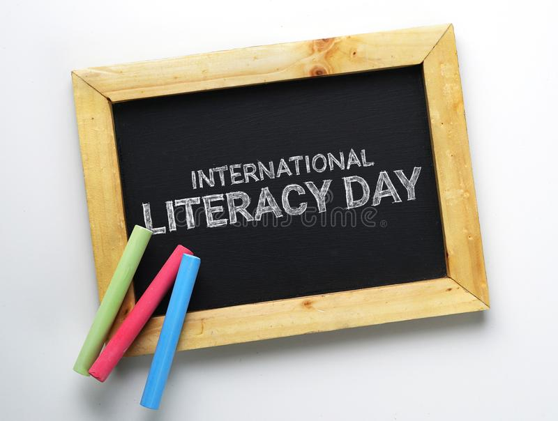 International Literacy Day. Wooden Frame Blackboard with Colorful Chalk royalty free stock images