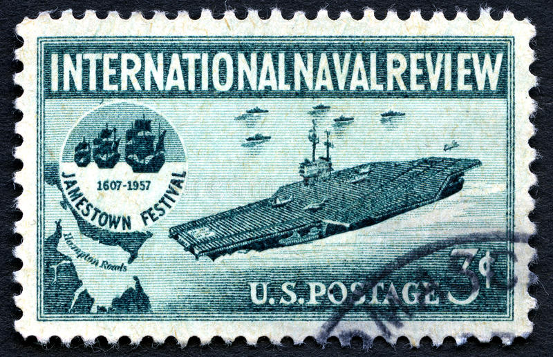 International Naval Review US Postage Stamp. UNITED STATES OF AMERICA - CIRCA 1957: A used postage stamp from the USA, depicting an Aircraft Carrier and the royalty free stock photo