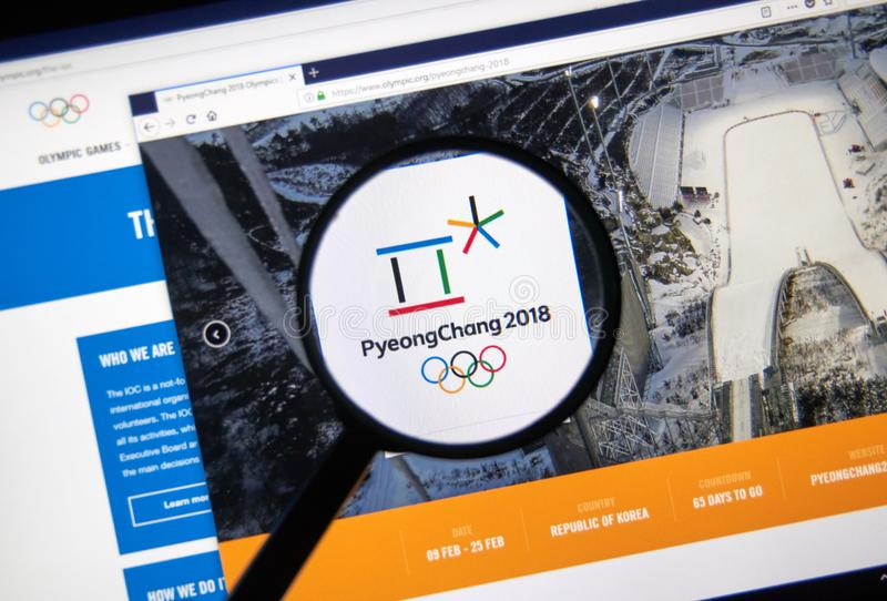 International Olympic Committee official web page. MONTREAL, CANADA - DECEMBER 5, 2017: International Olympic Committee official web page under magnifying glass royalty free stock images
