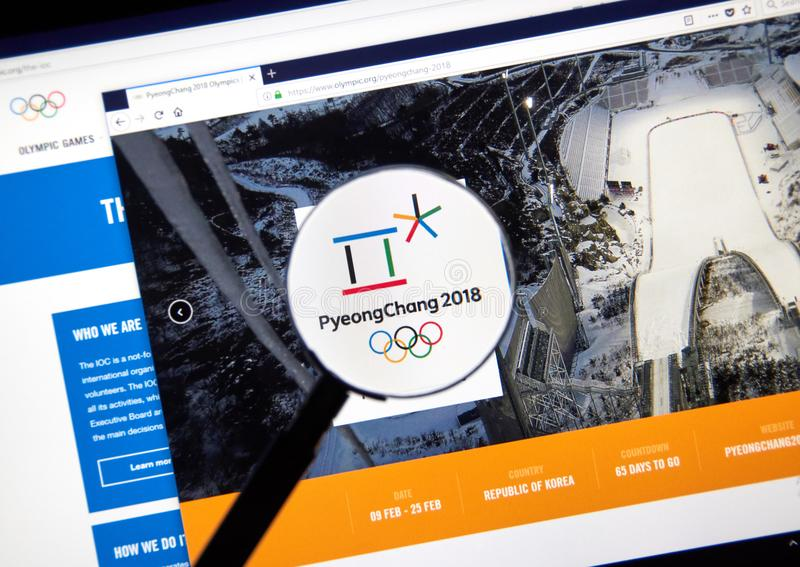 International Olympic Committee official web page. MONTREAL, CANADA - DECEMBER 5, 2017: International Olympic Committee official web page under magnifying glass royalty free stock photos