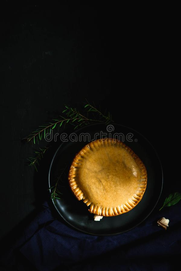 International puff and pie, Chicken pie, round and golden baked pie royalty free stock photography