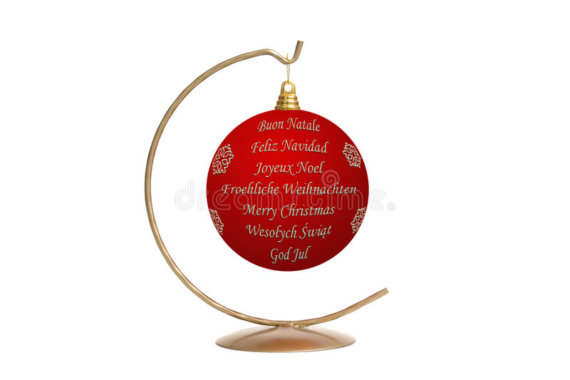 International seasonal greetings. Red christmas ball with seasonal greetings in seven languages - English, German, French, Italian, Spanish, Swedish and Polish royalty free stock images