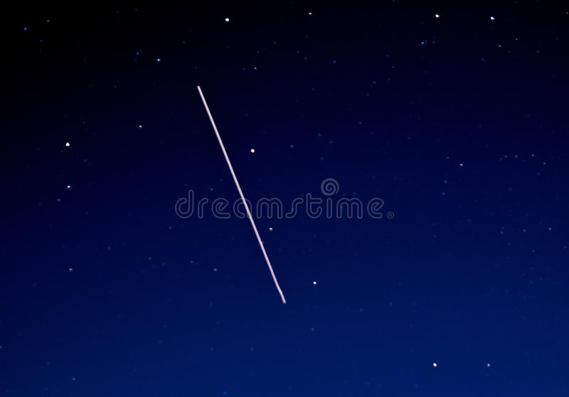 International Space Station (ISS). Flying at 30 degrees over Norfolk in February 2016. nThe International Space Station (ISS) is the most complex international stock photo
