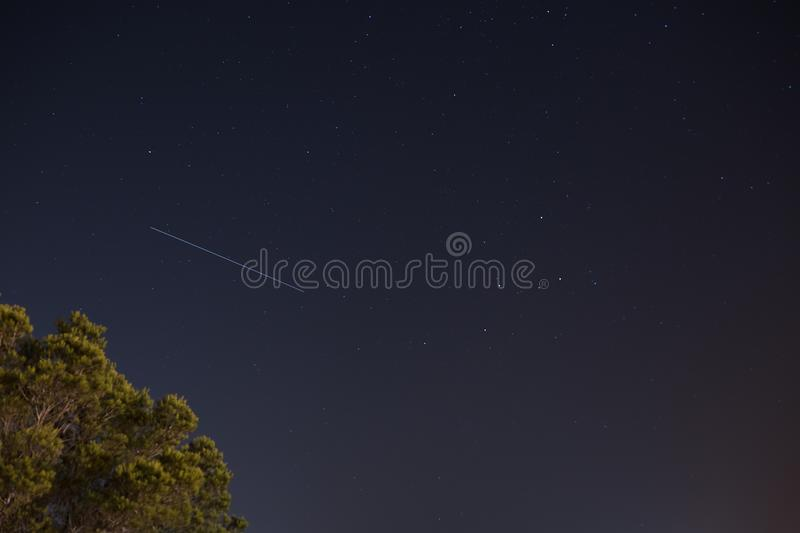 International Space Station ISS trail with cassiopeia constellation stock photo